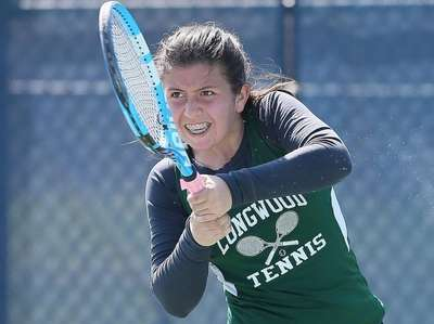 Longwood's Victoria Matos returns a shot back to