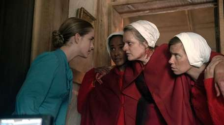 "Elisabeth Moss (center) in Hulu's ""The Handmaid's Tale."""