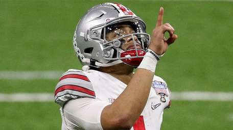Justin Fields of the Ohio State Buckeyes reacts