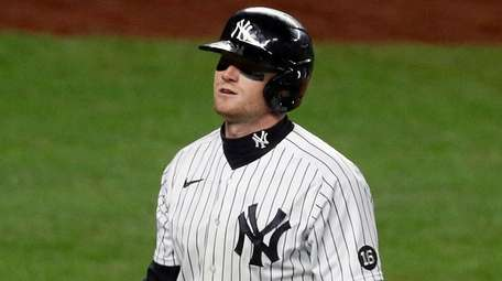 Clint Frazier of the Yankees walks back to