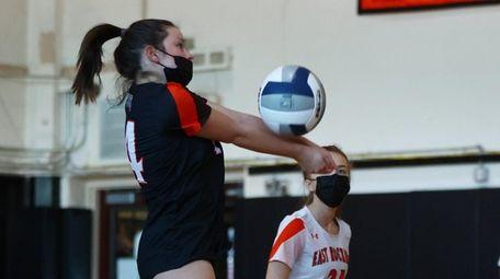 Riley O'Hagan of East Rockaway returns a serve