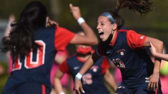 Ella Delmond of South Side reacts after scoring