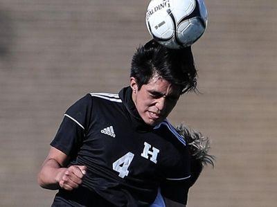 Hicksville's Guillermo Granados gets the header during the