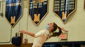 Alessandra Heimbauer of Massapequa jumpserves during the Nassau