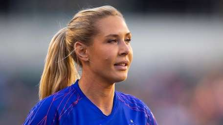 Allie Long #20 of the United States walks