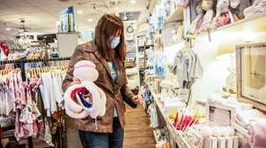 A woman shops for a friend's baby shower