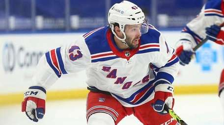Rangers forward Colin Blackwell controls the puck during