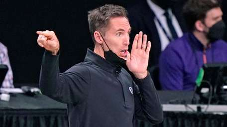 Nets head coach Steve Nash yells to his
