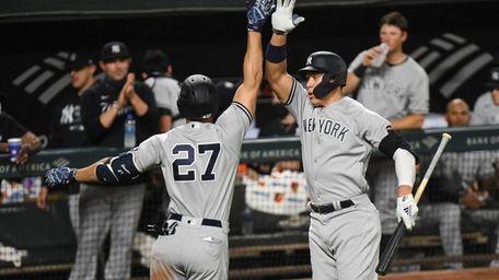 Yankees' Giancarlo Stanton (27) celebrates his seventh-inning home