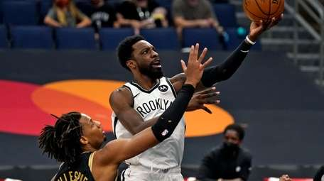 Nets forward Jeff Green (8) goes for a