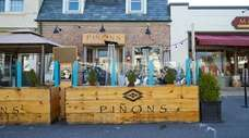 The outdoor dining setup at Piñon's Pizza Company