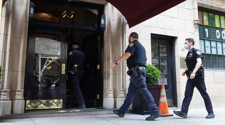 New York City police officers enter the lobby