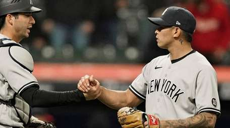 Yankees relief pitcher Jonathan Loaisiga, right, and catcher