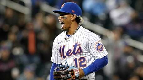 Francisco Lindor #12 of the Mets reacts after