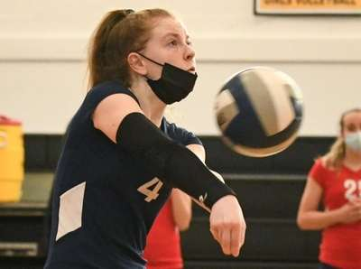 Camryn Hoffman of South Side bumps during the