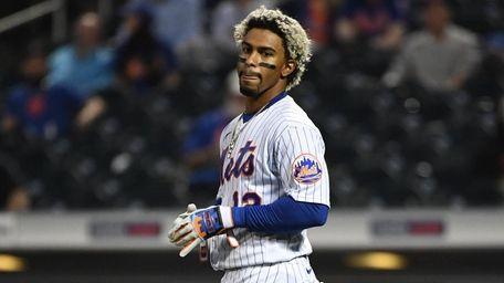 Mets shortstop Francisco Lindor looks on as he