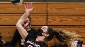 Wheatley's Lauren Hackett gets ready to spike at