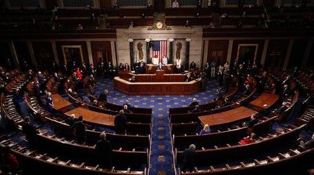 A social-distanced, reduced-capacity House chamber hosts Joe Biden's