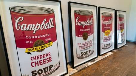 Portraits of Campbell's soup cans are among the