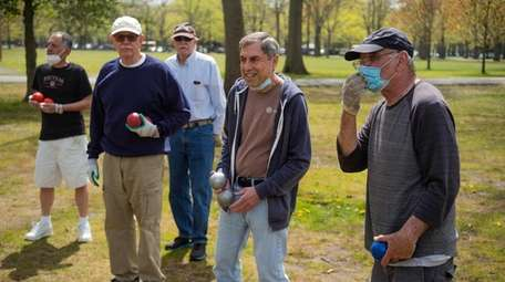 A group of men play Bocce in Eisenhower