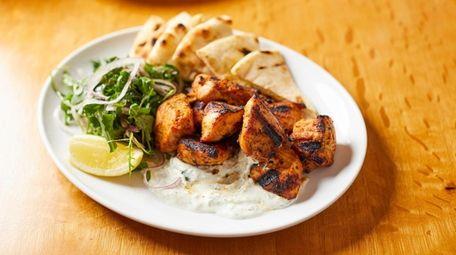 Chicken souvlaki platter with cascun farms chicken, pita,