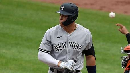 Yankees' Aaron Judge walks to the dugout after