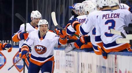 Anthony Beauvillier #18 of the Islanders celebrates his
