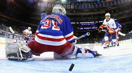 Josh Bailey #12 of the Islanders watches a