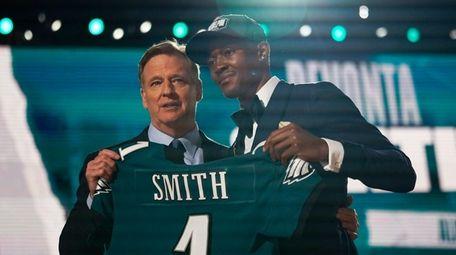 Alabama wide receiver DeVonta Smith, right, holds an