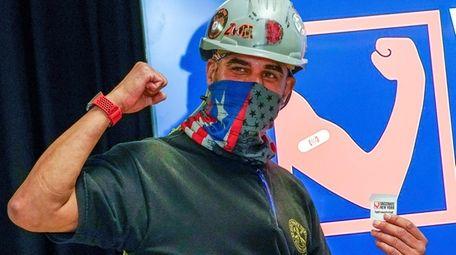 Local 28 Sheet Metal Worker Demetrius Buttelman celebrates
