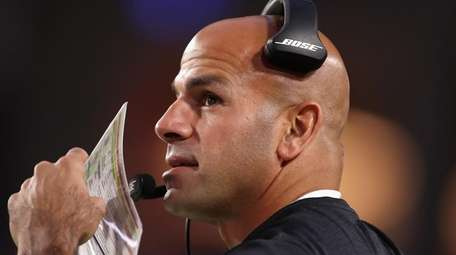 Robert Saleh watches from the sidelines during the