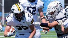 Massapequa's Timothy Morrow tries to shake the tackle