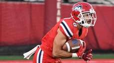 Stony Brook defensive back Augie Contressa runs with