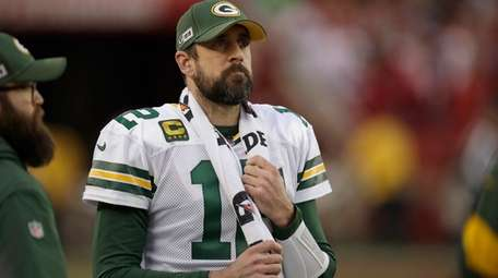 Green Bay Packers quarterback Aaron Rodgers watches from