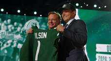Zach Wilson stands onstage with NFL Commissioner Roger