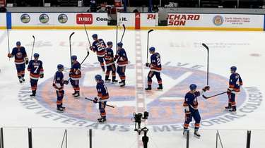 The Islanders celebrate after defeating the Rangers and