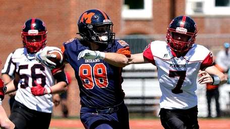 Manhasset's Aiden Mulholland (88) breaks into the secondary