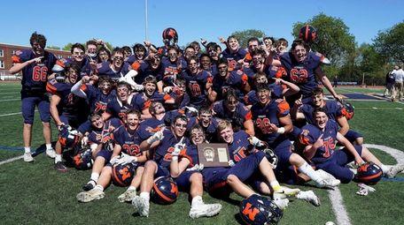 Manhasset's football team celebrates their victory over Plainedge