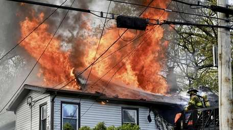 Flames on the roof of a home Sunday