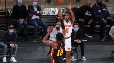 New York Knicks guard Immanuel Quickley (5) shoots