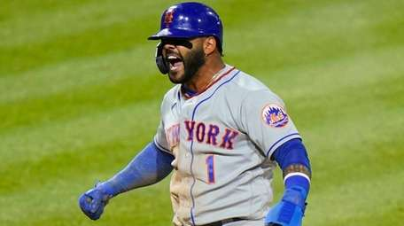 New York Mets' Jonathan Villar reacts after scoring