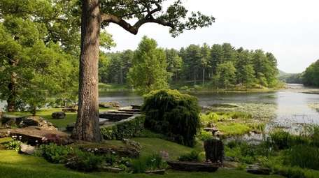 A garden next to a lake at Innisfree