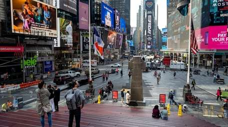 Sparse visitors and pedestrians seen in Manhattan's Times