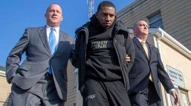 Jamik Cannon leaves Nassau County police headquarters in
