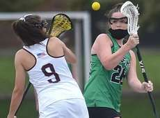 Demi Hecker #26 of Farmingdale, right, and Juliana