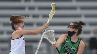 Demi Hecker #26 of Farmingdale, right, and Kendal