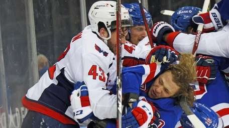 The Capitals' Tom Wilson takes a roughing penalty