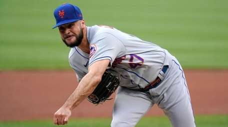 Mets starting pitcher Joey Lucchesi throws during the