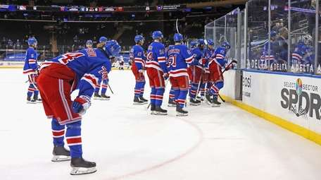 The Rangers leave the ice following a 6-3