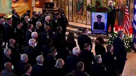 Family, friends and fellow cops gathered in Greenlawn